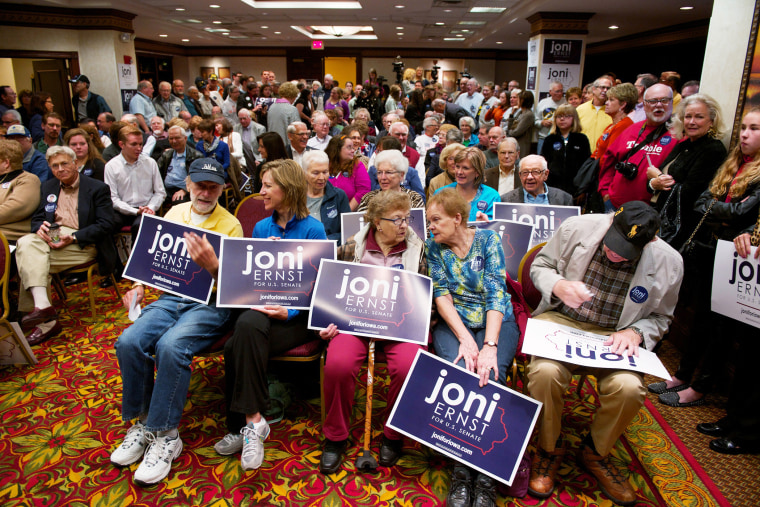Supporters of Iowa Republican State Senator and U.S. Senate candidate Joni Ernst wait for a rally on Oct. 11, 2014 in Cedar Rapids, Iowa. (Photo by David Greedy/Getty)