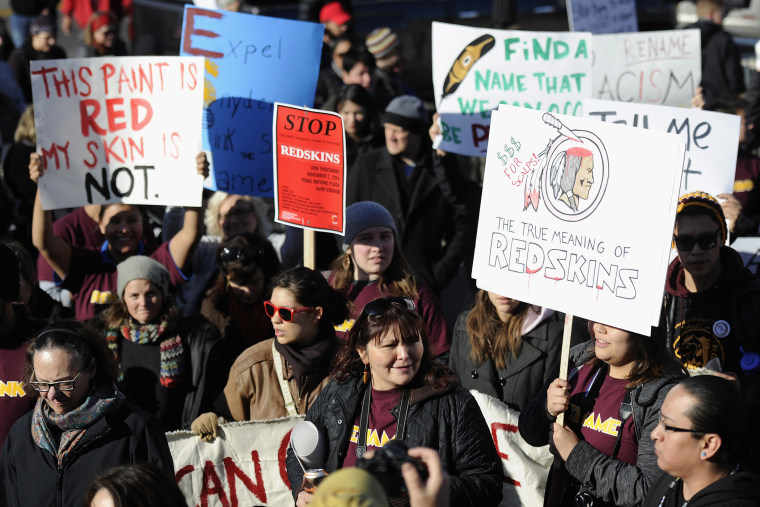 People march to TCF Bank Stadium to protest against the mascot for the Washington Redskins before the game against the Minnesota Vikings on Nov. 2, 2014 in Minneapolis, Minn. (Hannah Foslien/Getty)