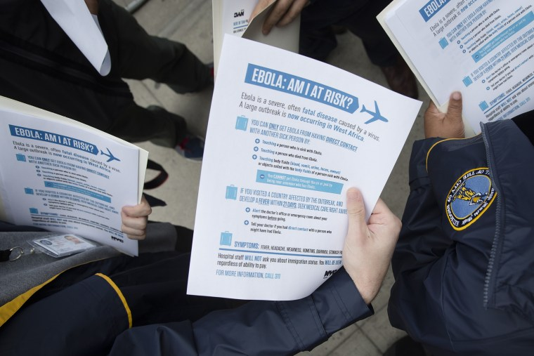 Members of the Brooklyn Borough President's office hand out fliers detailing the risks of Ebola on Oct. 24, 2014. (John Minchillo/AP)