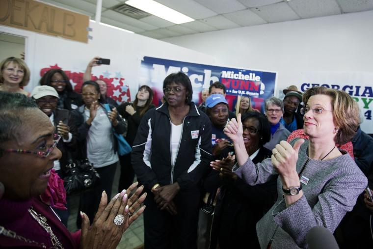 Georgia U.S. Senate Democratic candidate Michelle Nunn, right, greets supporters at a campaign field office, Monday, Nov. 3, 2014, in Decatur, Ga. (Photo by David Goldman/AP)