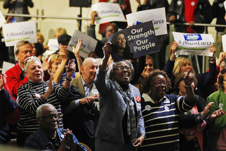 Campaign supporters cheer for Democratic Senate candidate Alison Lundergan Grimes during a campaign rally at the Kentucky Center for African American Heritage in Louisville, Ky. on Nov. 3, 2014.