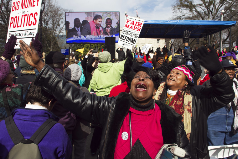 "Kathy Jones reacts during the closing remarks by Rev. William Barber during the ""Moral March on Raleigh"" in Raleigh, N.C. on Feb. 8, 2014."