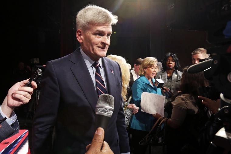 Senate candidate, Rep. Bill Cassidy, left, talks to the media in Shreveport, La. on Oct. 14, 2014.