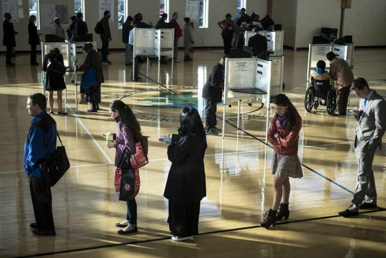 Voters cast their ballots while others wait their turn at the Kennedy Recreation Center on Nov. 4, 2014 in Washington, DC.