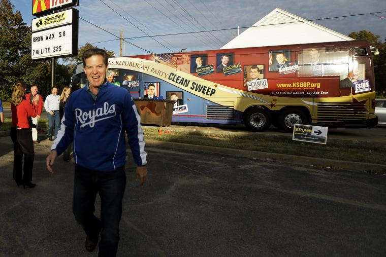 Kansas Republican Gov. Sam Brownback arrives at a campaign event on Nov. 1, 2014, in Topeka, Kan.