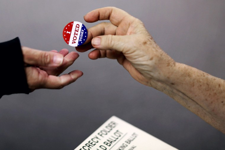 Voters get an 'I VOTED TODAY' sticker after casting their ballots on election day at the Red Oak Fire Department on Nov. 4, 2014 in Red Oak, Iowa.