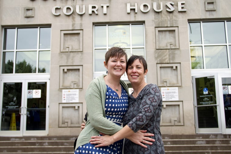 In this photo provided by Liz Dickinson, Kelli, left, and Angela pose for a picture after their wedding ceremony at the Johnson County Court House in Olathe, Kan., Friday, Oct. 10, 2014. (Liz Dickinson-Snyder/piperlucyphotography.org/AP)