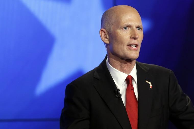 Florida Republican Gov. Rick Scott responds to a question during a gubernatorial debate against Democrat Charlie Crist on Oct. 10, 2014, in Miramar, Fla. (Photo by Lynne Sladky/AP)