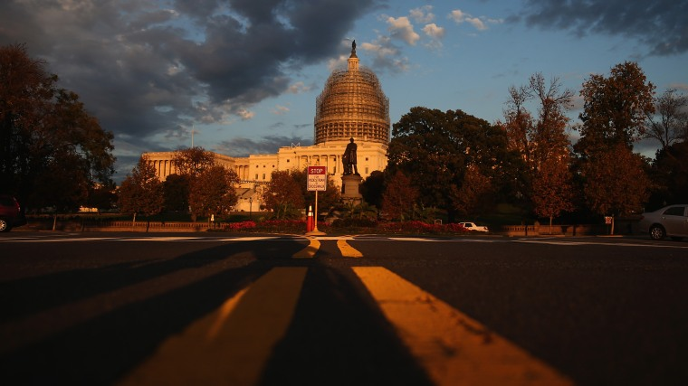 The afternoon sun hits the U.S. Capitol on the eve of the nation's mid-term elections, Nov. 3, 2014 in Washington, D.C. (Photo by Mark Wilson/Getty)