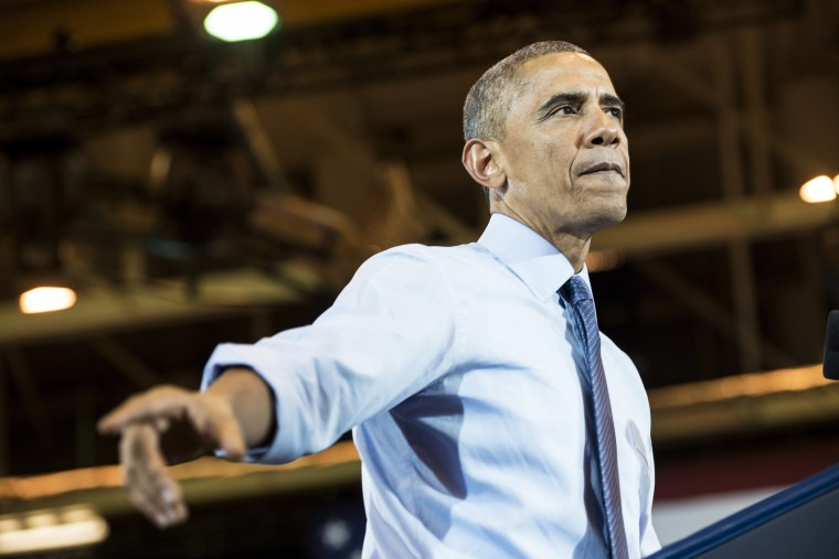 US President Barack Obama speaks during a rally at North Division High School on Oct. 28, 2014 in Milwaukee, Wis. (Photo by Brendan Smialowski/AFP/Getty)