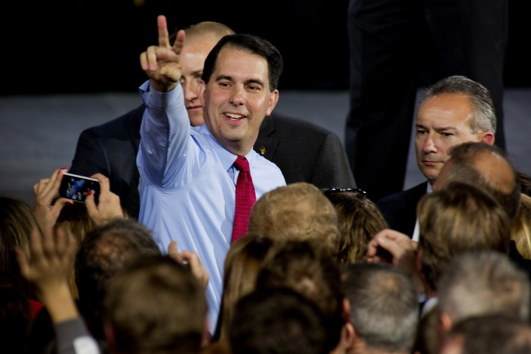 Wisconsin Gov. Scott Walker greets supporters at his election night party November 4, 2014 in West Allis, Wisc. (Darren Hauck/AP)