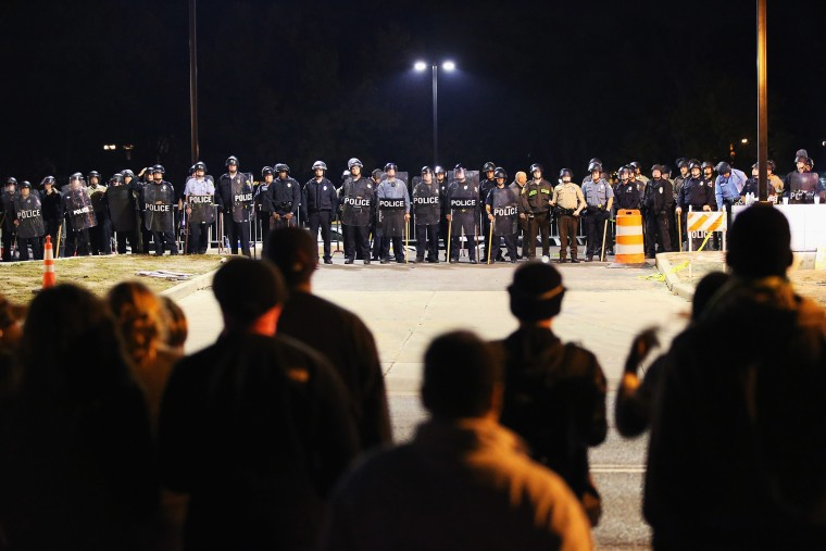 Police face off with demonstrators outside the police station as protests continue in the wake of 18-year-old Michael Brown's death on Oct. 22, 2014 in Ferguson, Mo.