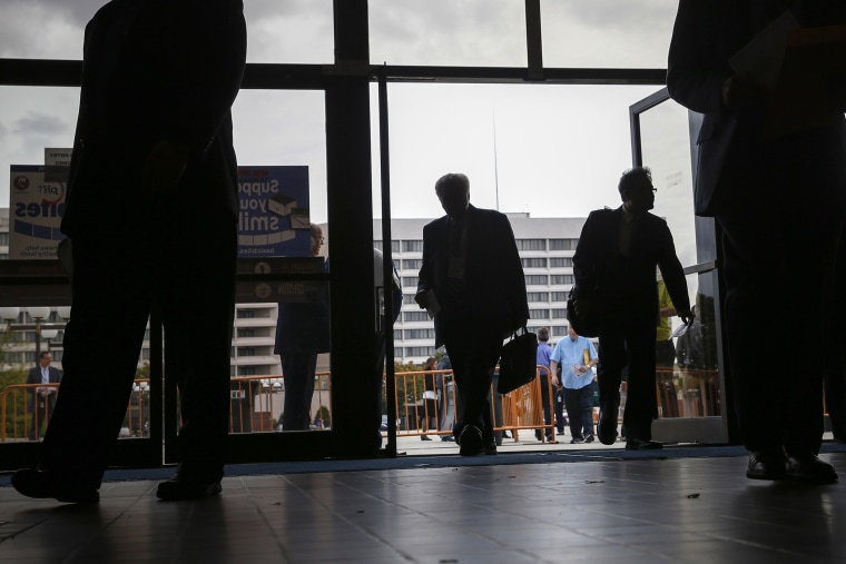 People enter the Nassau County Mega Job Fair at Nassau Veterans Memorial Coliseum in Uniondale, New York on Oct. 7, 2014.