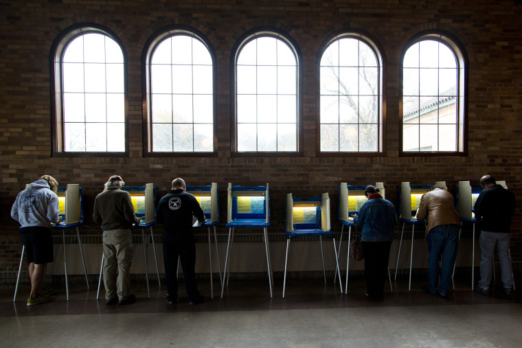 Citizens go to the cast their ballots at the South Shore Park building on election day Nov. 4, 2014 in Milwaukee, Wis. (Photo by Darren Hauck/Getty)