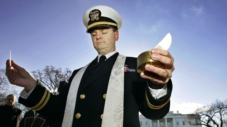 Navy Chaplain Lt. Gordon J. Klingenschmitt is pictured as he conducts a worship service in front of the White House, background, Saturday, Jan. 7, 2006, in Washington, D.C. (Photo by Manuel Balce Ceneta/AP)
