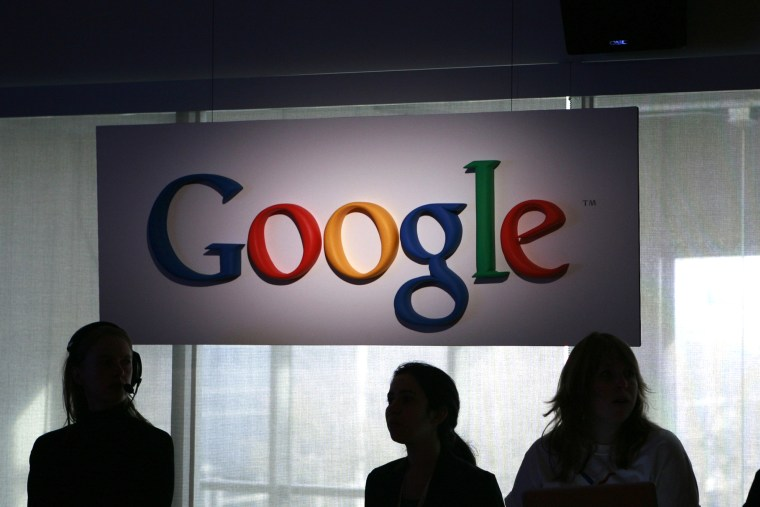 Attendees stand during a news conference at Google headquarters in Mountain View, California. (Photo by Robert Galbraith/Reuters)
