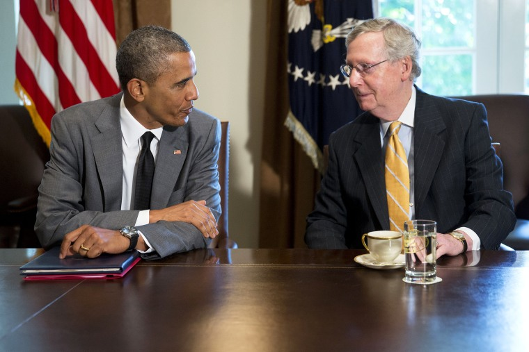 President Barack Obama talks to U.S. Senate Republican Leader Mitch McConnell (R-Ky.) during a meeting with members of Congress in Washington, D.C. on July 31, 2014. (Photo by Andrew Harrer/Picture-Alliance/DPA/AP)