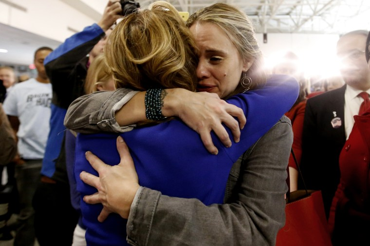 Democratic U.S. Senator Kay Hagan (L) of North Carolina is hugged by a supporter after her concession speech acknowledging her defeat by challenger Thom Tillis at her midterm election night rally in Greensboro, North Carolina on Nov. 4, 2014.