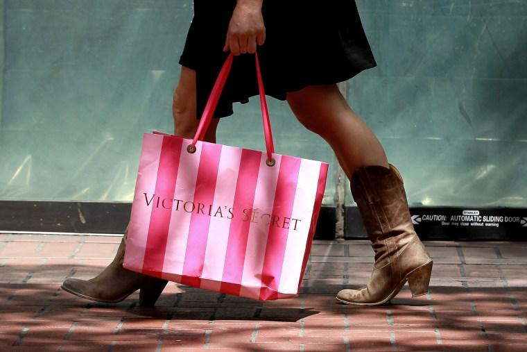 A shopper carries a Victoria's Secret bag as she walks along Market Street on July 29, 2011 in San Francisco, Calif.
