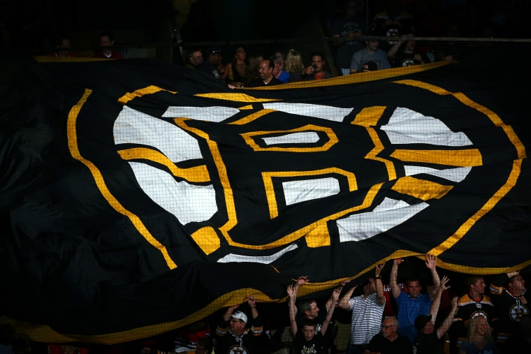 Boston Bruins fans hold a giant flag with the Boston Logo on it prior to a game in Boston, Massachusetts.