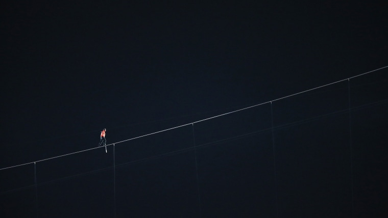 Tightrope walker Nik Wallenda walks on a 3/4 inch diameter wire on November 2, 2014.