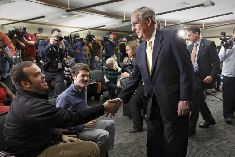 Senate Republican leader Mitch McConnell of Kentucky shakes hands with students at the University of Louisville's McConnell Center for political studies on Nov. 5, 2014. (J. Scott Applewhite/AP)