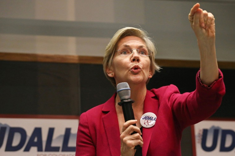 U.S. Sen. Elizabeth Warren speaks to a crowd during a rally to urge the reelection of Colo. Sen. Mark Udall to the Senate in Boulder, Colo. on Oct. 17, 2014. (Brennan Linsley/AP)