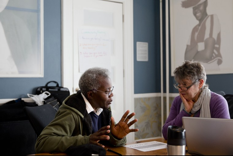 Shareda Green, left, meets with Barbara Bloomfield a volunteer with the Pennsylvania Health Access Network to begin the process of signing up for insurance under the Affordable Care Act, on March 31, 2014 in Philadelphia.