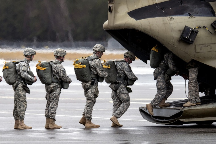 Paratroopers of the US Army enter a helicopter at the training area in Grafenwoehr, Germany on Feb. 10, 2014.