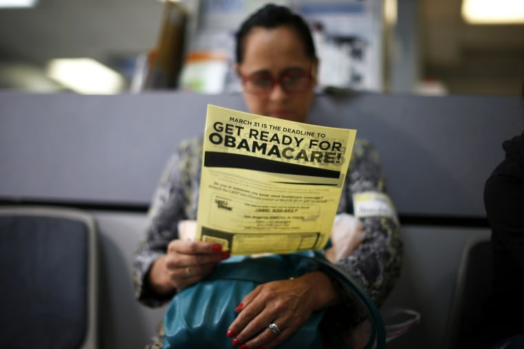 Arminda Murillo, 54, reads a leaflet at a health insurance enrollment event in Cudahy, Calif., March 27, 2014. (Photo by Lucy Nicholson/Reuters)