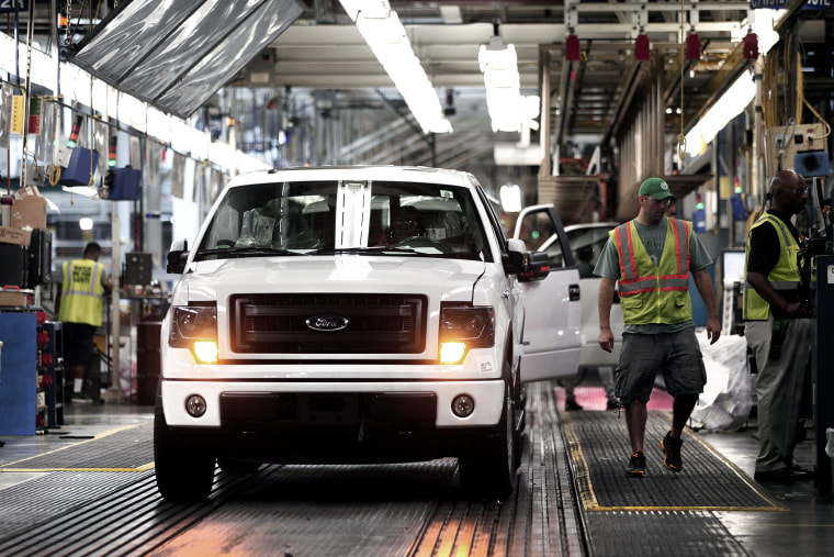 Ford F-150 trucks are prepared to come off the assembly line at the Ford Dearborn Truck Plant on June 13, 2014 in Dearborn, Mich.