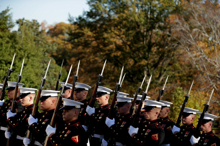 Honor guards for all branches of the U.S. military arrive for a wreath laying ceremony at The Tomb of the Unknowns on Nov. 11, 2014 in Arlington, Va.