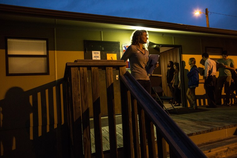 Voters wait in line to cast their ballots in a portable structure outside of David Chapel Baptist Church on Tuesday, Nov. 4, 2014 in Austin, Texas. (Photo by Tamir Kalifa/AP)