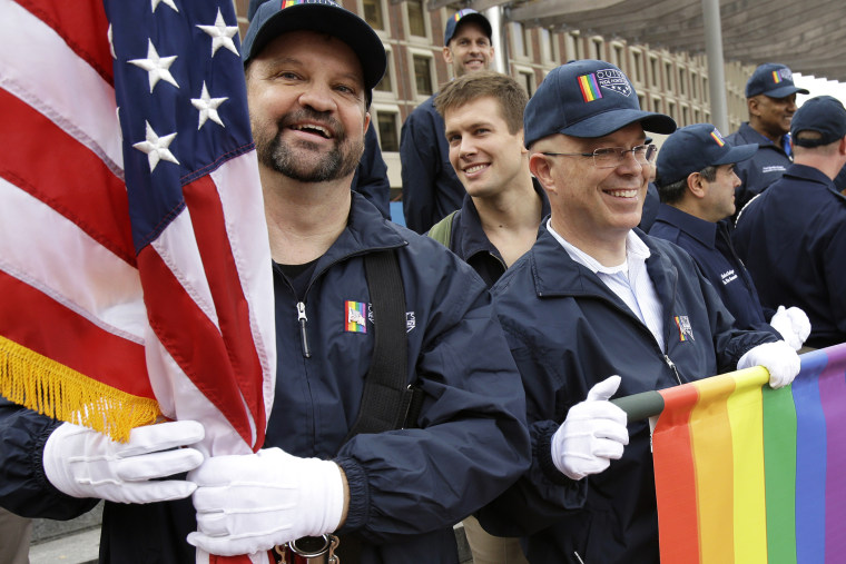 Retired U.S. Air Force Master Sgt. Eric Bullen, of Westborough, Mass., left, and U.S. Army veteran Ian Ryan, of Dennis, Mass.are seen after marching with a group representing LGBT military veterans in a Veterans Day parade, Nov. 11, 2014, in Boston, Mass.