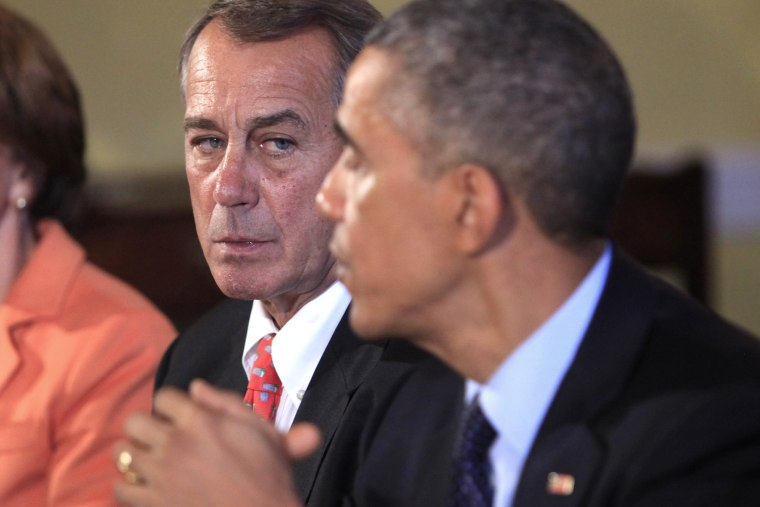 Speaker of the House John Boehner looks on as U.S. President Barack Obama meets with bipartisian congressional leadership in the Old Family Dining Room at the White House on Nov. 7, 2014 in Washington, DC.
