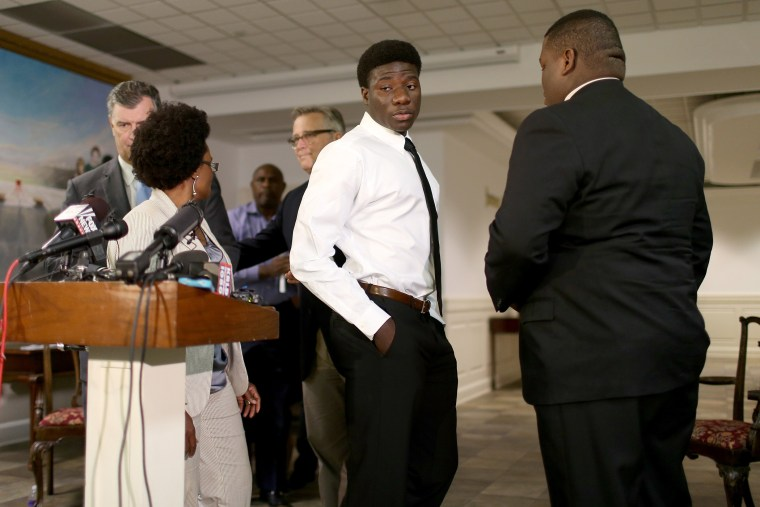 Karsiah Duncan, (C) the son of Ebola patient, Thomas Eric Duncan, leaves after speaking to the media at the Wilshire Baptist Church on Oct. 7, 2014 in Dallas, Texas.