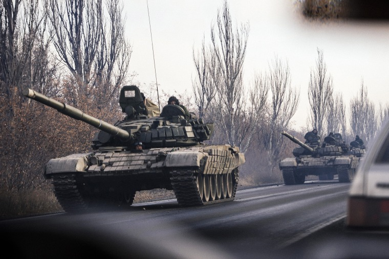 A column of tanks drive from a rebel-territory to Donetsk near the town of Shakhtarsk, eastern Ukraine on Nov. 10, 2014. (Photo by Dimitar Dilkoff/AFP/Getty)