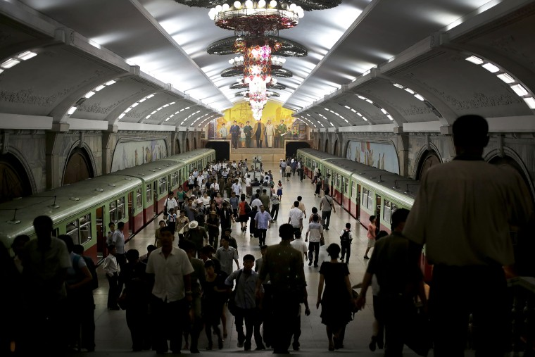 North Koreans make their way to and from a train platform in an underground subway station, Sept. 1, 2014 in Pyongyang, North Korea.