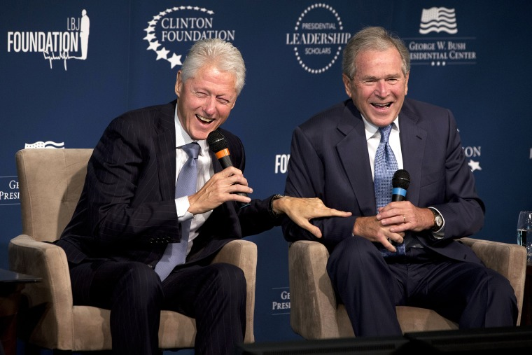 Former Presidents Bill Clinton, left, and George W. Bush, laugh while participating in the Presidential Leadership Scholars Program Launch, Sept. 8, 2014, at The Newseum in Washington, D.C. (Photo by Jacquelyn Martin/AP)