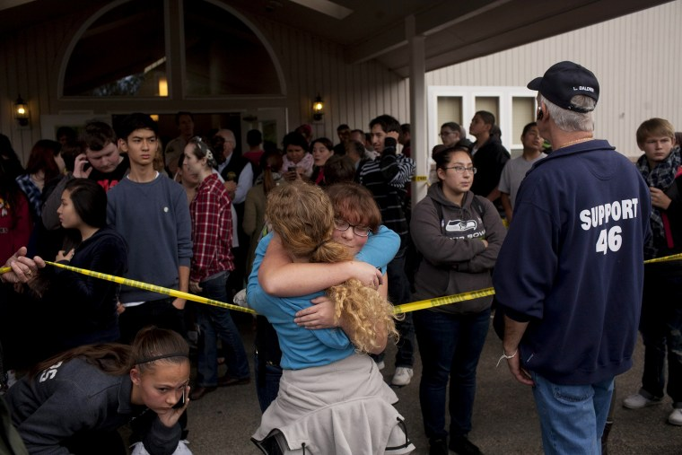 Students gather with parents and at Shoults Gospel Hall in Marysville, Wash. on Oct. 24, 2014, after a school shooting that occured at the Marysville-Pilchuck High School nearby.