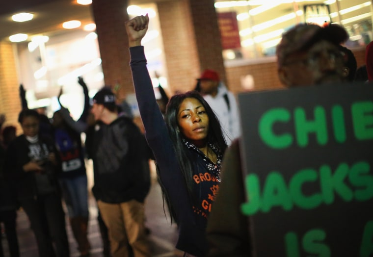 Demonstrators face off with police as protests continue in the wake of 18-year-old Michael Brown's death on Oct. 22, 2014 in Ferguson, Mo.