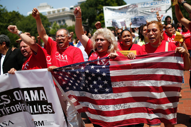 Immigration reform protesters march during an immigration rally July 7, 2014 in Washington, D.C. (Photo by Win McNamee/Getty)