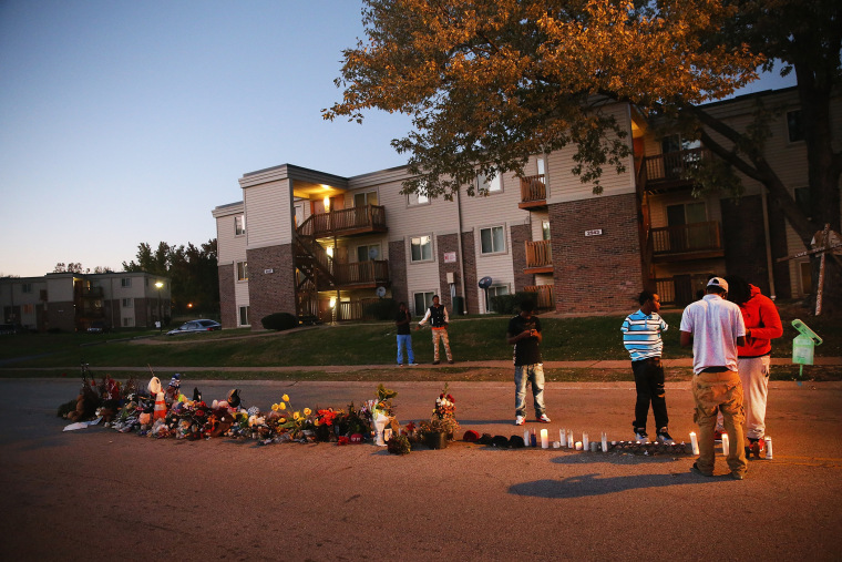 Neighborhood residents hang out at a memorial for 18-year-old Michael Brown on Canfield Street on Oct. 20, 2014 in Ferguson, Mo. (Photo by Scott Olson/Getty)