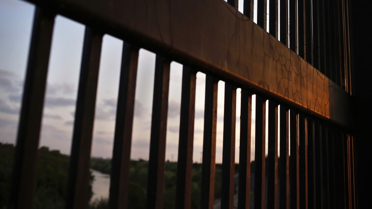 The border fence stands at the United States-Mexico border along the Rio Grande river in Brownsville, Texas, Aug. 5, 2014. (Photo by Shannon Stapleton/Reuters)