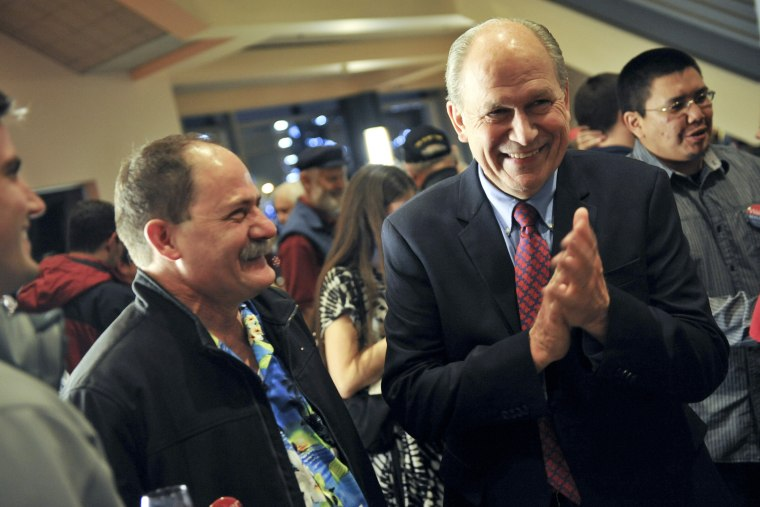 Alaska Independent gubernatorial candidate Bill Walker, right, laughs while awaiting election results, Nov. 4, 2014, in Anchorage, Alaska. (Photo by Michael Dinneen/AP)