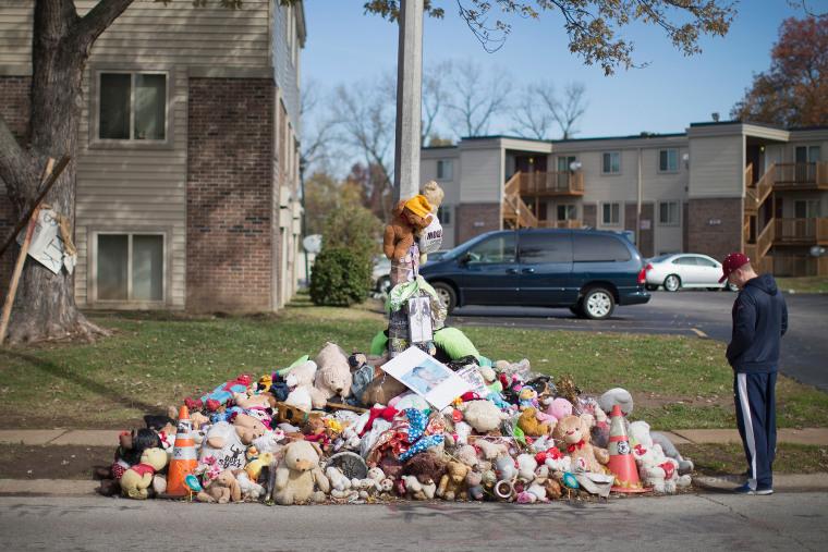 Greg Bajema views the memorial of stuffed animals, flowers, tee-shirts and ball caps that remains on Nov. 5, 2014 in Ferguson, Mo. (Scott Olson/Getty)