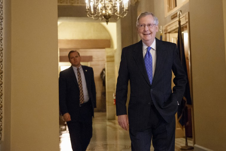 Senate Minority Leader Mitch McConnell of Ky. smiles as he arrives for a meeting of Senate Republicans on Nov. 13, 2014. (J. Scott Applewhite/AP)