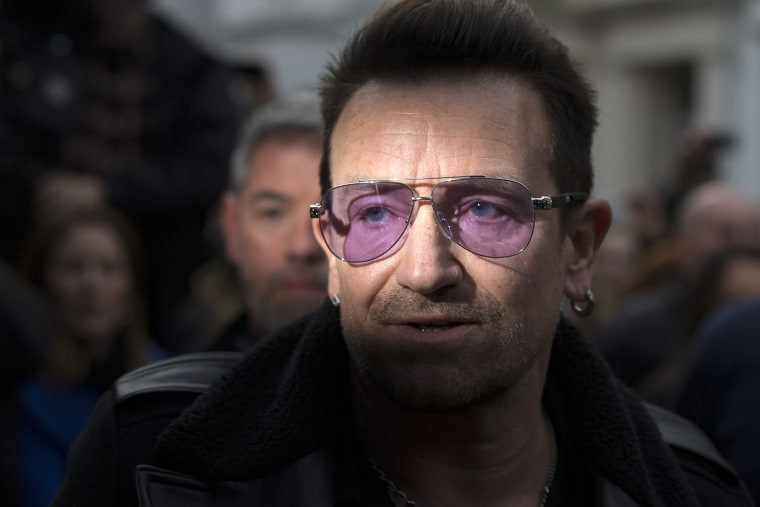 U2 frontman Bono arrives at a west London studio to record the new Band Aid 30 on Nov. 15, 2014. (ANDREW COWIE/AFP/Getty)