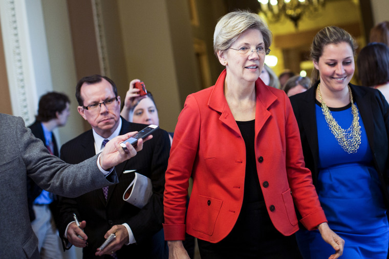 Sen. Elizabeth Warren (D-Mass.) exits a Democratic caucus meeting on Capitol Hill in Washington, Nov. 13, 2014. (Photo by Drew Angerer/The New York Times/Redux)