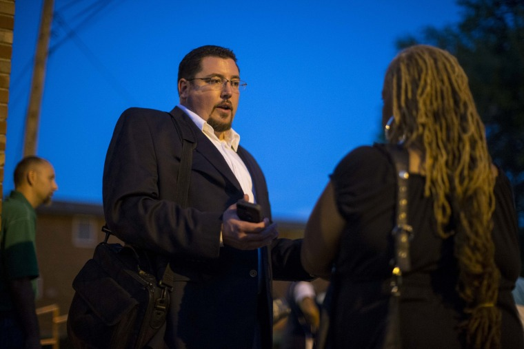 Ferguson Mayor James Knowles (L) speaks with resident Juanita Stone after a town hall meeting with local government officials and residents on Sept. 30, 2014 at Our Lady of Guadalupe in Ferguson, Mo. (Whitney Curtis/Getty)
